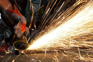 9309941-sparks-while-grinding-in-a-steel-factory-Stock-Photo-grinding-welder-metal